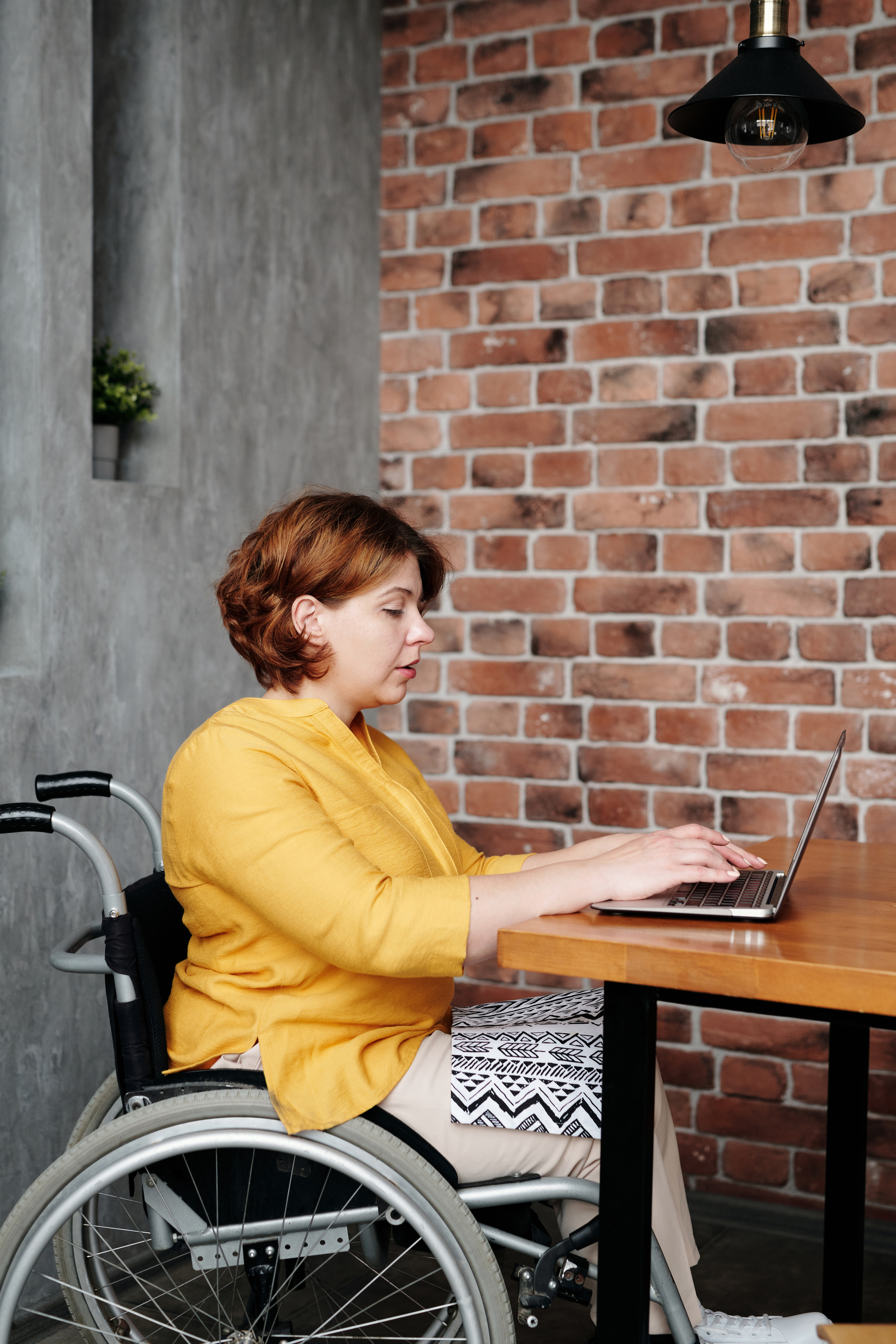 Woman in wheelchair at her computer